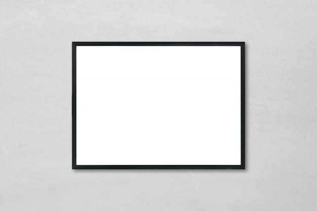 방에 흰색 대리석 벽 배경에 매달려 빈 포스터 액자를 비웃는 다.
