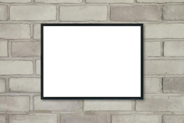 Макет пустой плакат фоторамка на кирпичной стене.