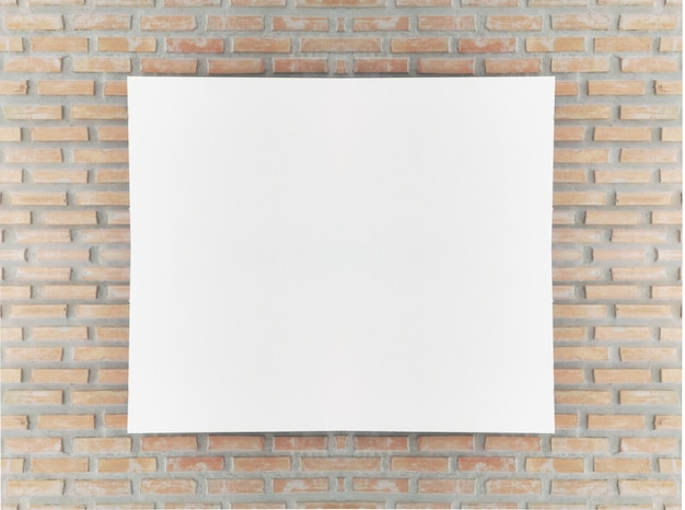 벽돌 벽에 빈 포스터 액자를 비웃는 다.