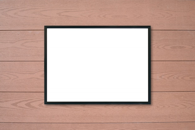 Mock up blank poster picture frame on wood wall.