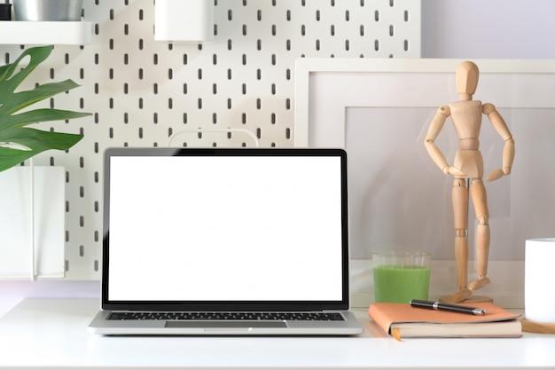 Mock up blank screen laptop in loft working space