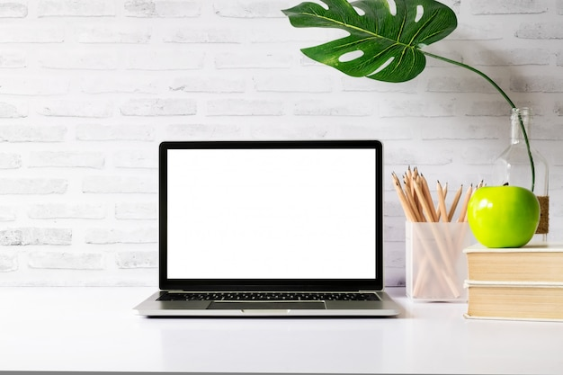 Mock up blank white screen laptop.