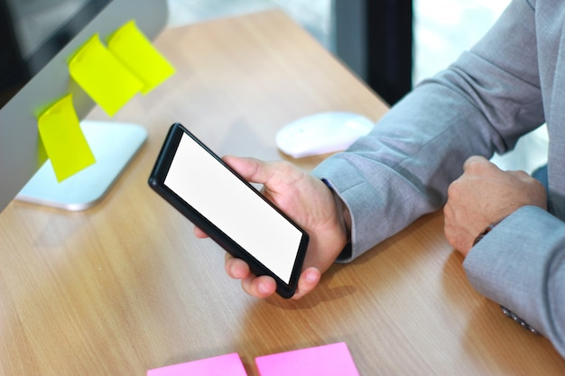 Mock up of a business man holding smartphone device