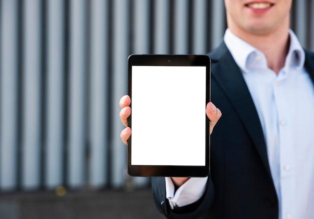 Mock-up businessman holding tablet