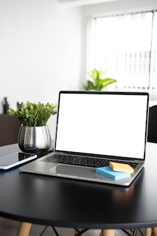Mock up computer laptop on office desk.