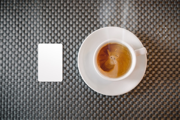 Mock up of credit card near coffee cup