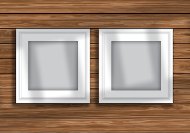 Mock up display with blank picture frames on wooden texture