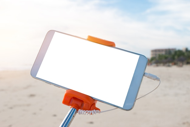 Mock up extensible selfie stick or mono pod with mobile phone taking picture