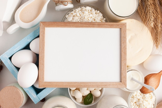 Mock-up frame surrounded by dairy products