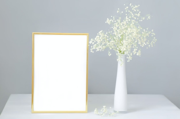 Mock-up frame with bouquet of white gypsophila
