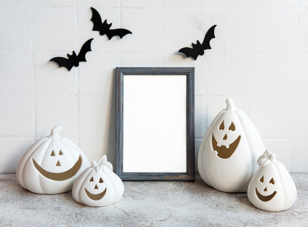 Mock up  frame with jack o lantern and pumpkin decor on a table halloween concept