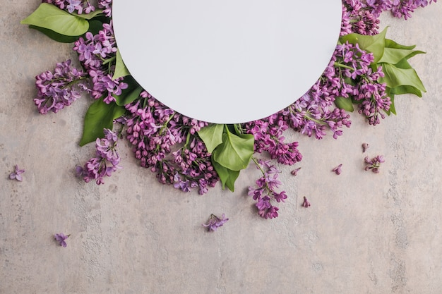 Mock up frame with lilac flowers on purple background
