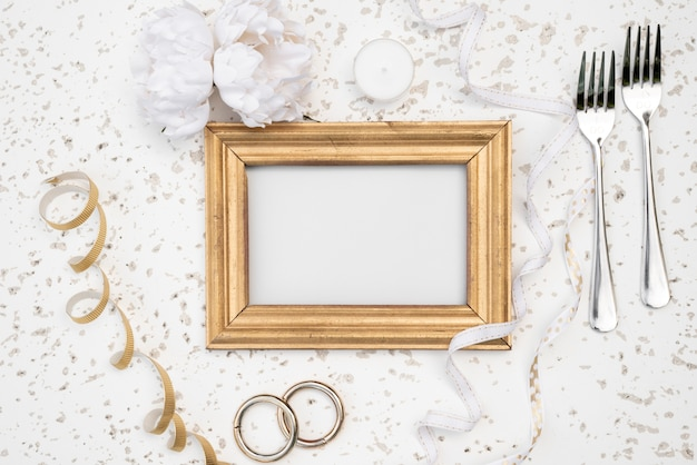 Mock-up frame with wedding rings