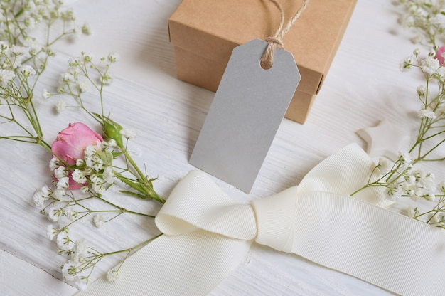 Mock up gift box with gift card and flowers rustic style
