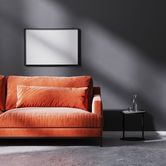 Mock up horizontal frame on black wall with sun rays with red sofa with black coffee table, raw concrete floor, 3d rendering