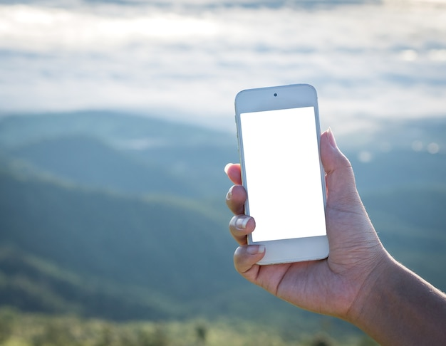 Mock up image of  woman hand holding white smartphone with blank white screen