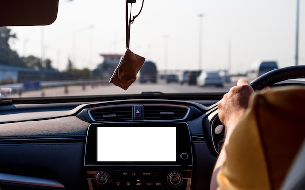 Mock up of isolated blank screen monitor in car for your advertising.