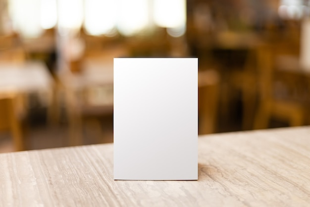 Mock up label the blank menu frame in bar restaurant. stand for booklet with white sheet paper acrylic tent card