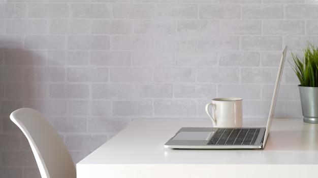 Mock up laptop on white workspace