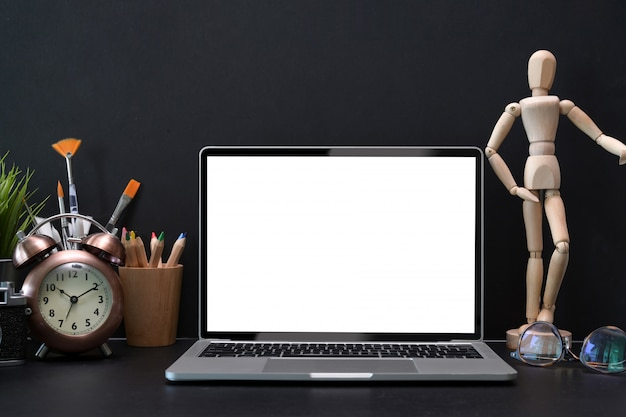 Mock-up laptop with white blank screen on designer working place
