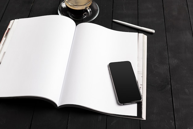 Mock-up magazine or catalog on a wooden table.