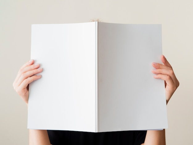 Mock-up magazine held by a woman