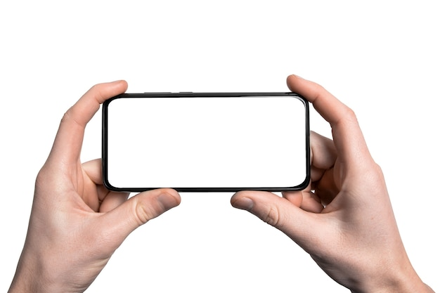 Mock up, mockup.man hand holding the black smartphone with frame less blank screen and modern frameless design,vertical - isolated on white background.clipping path.ui design interface.
