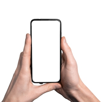 Mock up, mockup.man hand holding the black smartphone with frame less blank screen and modern frameless design,vertical