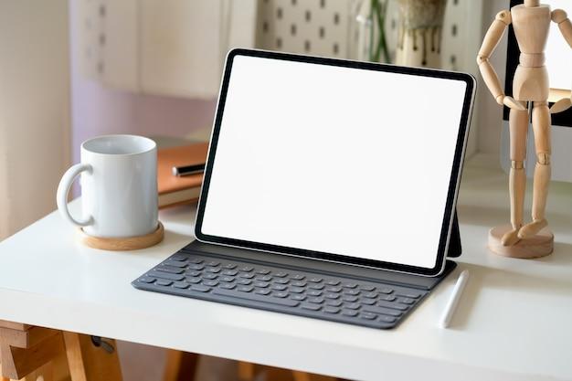 Mock up modern digital tablet on workspace