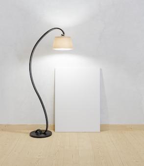 床に置かれた帆布のモックアップとそれを照らすランプ