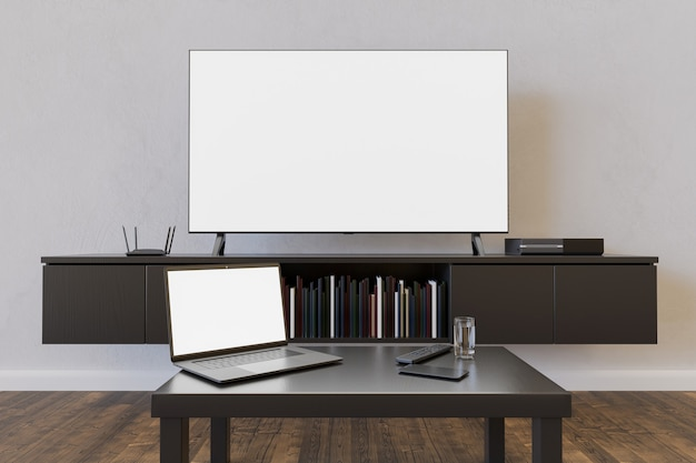 本と小さなテーブルのあるリビングルームでのテレビとラップトップのモックアップ。 3dレンダリング