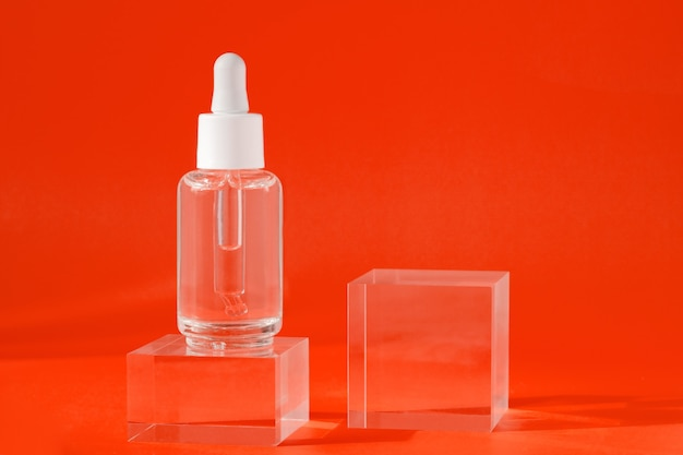 Mock up packaging product design branding cosmetic serum liquid mockup in transparent bottle on