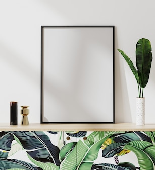 Mock up picture frame in tropical mood modern interior with white wall, standing on chest of drawers with palm leaves print, 3d rendering