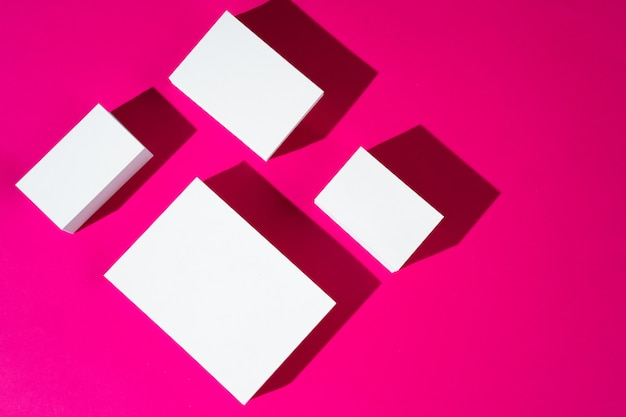 Mock-up on pink background. businesscards with copy space