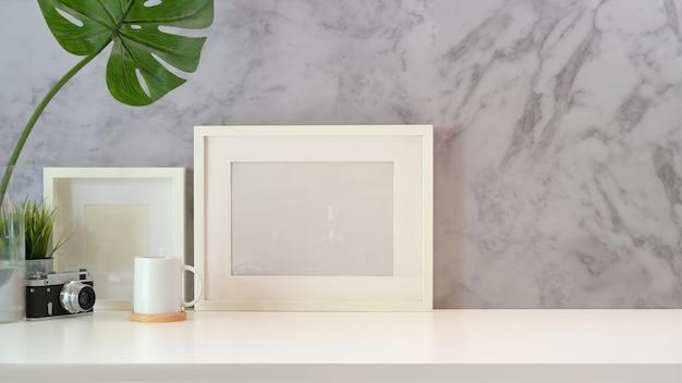 Mock up poster empty frame on minimal workspace