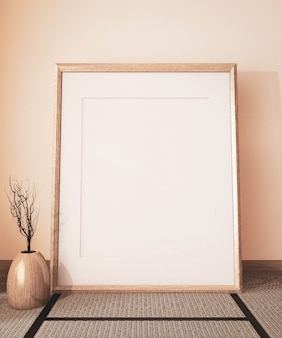 Mock up poster frame on empty room japanese  and tatami mat floor, earth tone.3d rendering