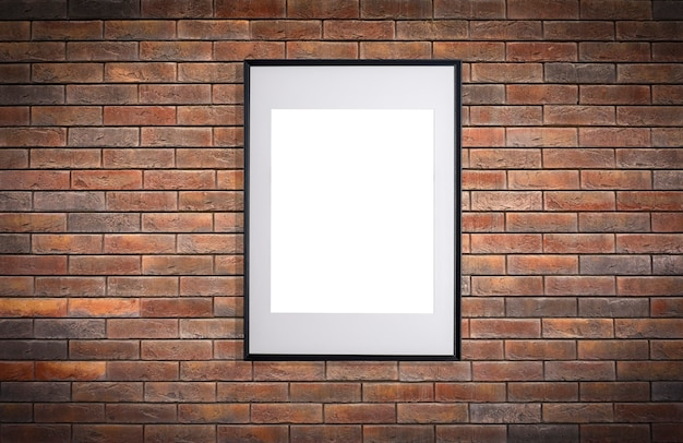 Mock up poster frame in interior wall white frame for poster or photo image on brick loft wall