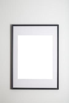 Mock up poster frame in interior white wall white frame for poster or photo image
