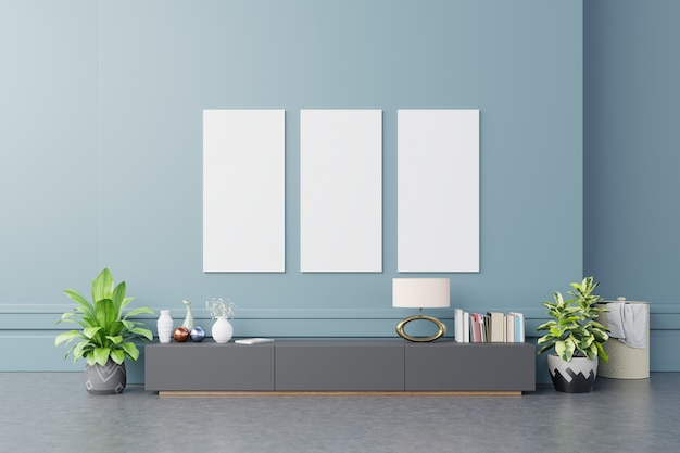 Mock up poster frames on cabinet in interior dark blue wall