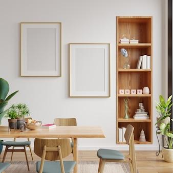 白い空の壁とモダンなダイニングルームのインテリアデザインのポスターをモックアップします。3dレンダリング