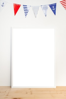 Mock up poster in a white frame on white background with garland
