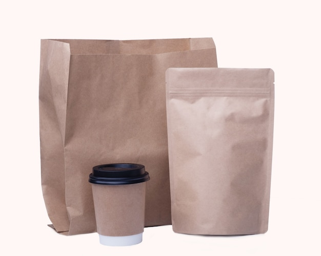 Mock up of recycling  paper cup, paper bag, coffee bean bag on white background