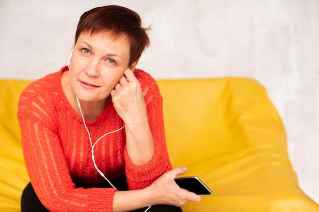 Mock-up senrior female listening music