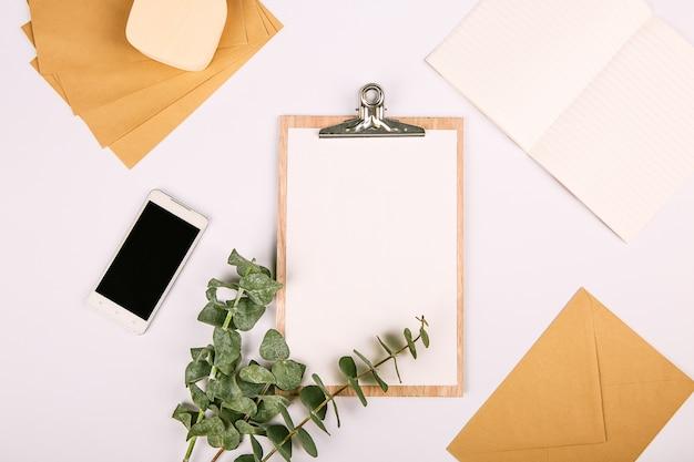 Mock up set business tablet phone plants notebook