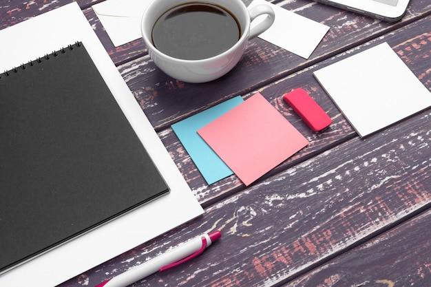 Mock up set of id template, notebook and cup of coffee. coffee break
