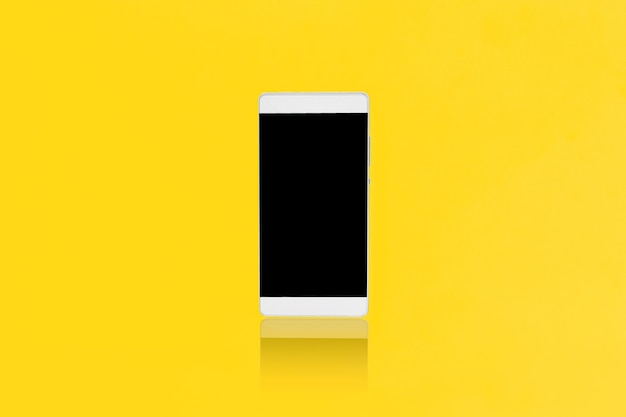 Mock up smart-phone on a yellow background, design for advertising