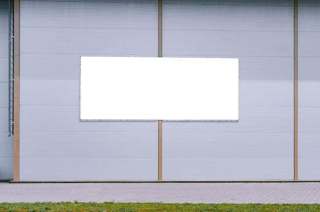 Mock up of a street billboard on a gray sandwich panel background.