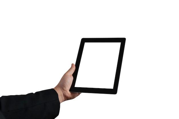 モックアップ技術。男は白い背景に白い画面でタブレットを持っています。