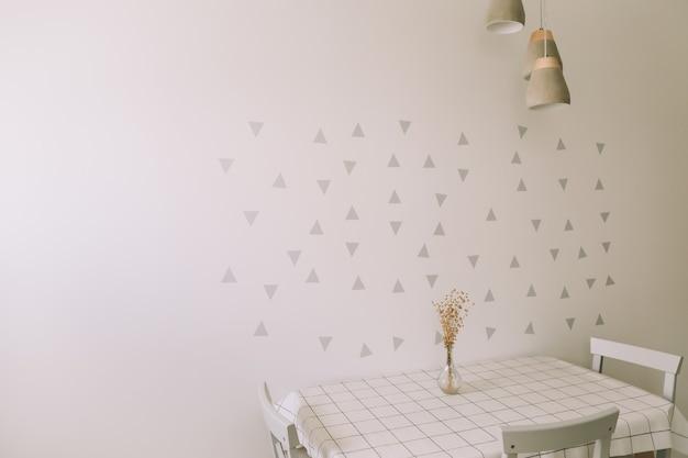 Макет стены в современном интерьере кухни со столом и стулом