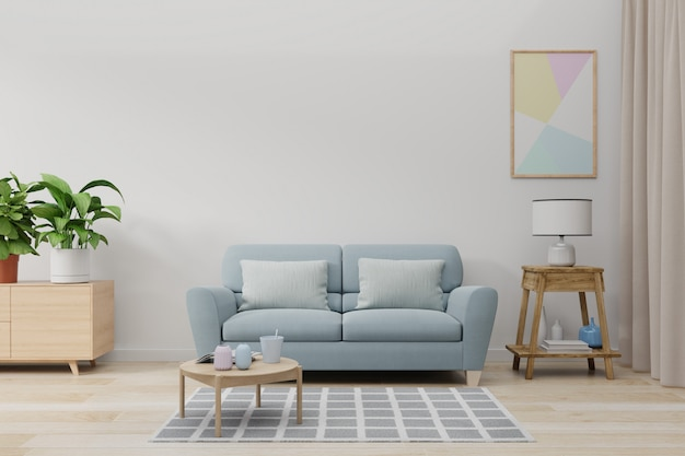 Mock up wall in living room with blue sofa, plants and table on empty white wall.
